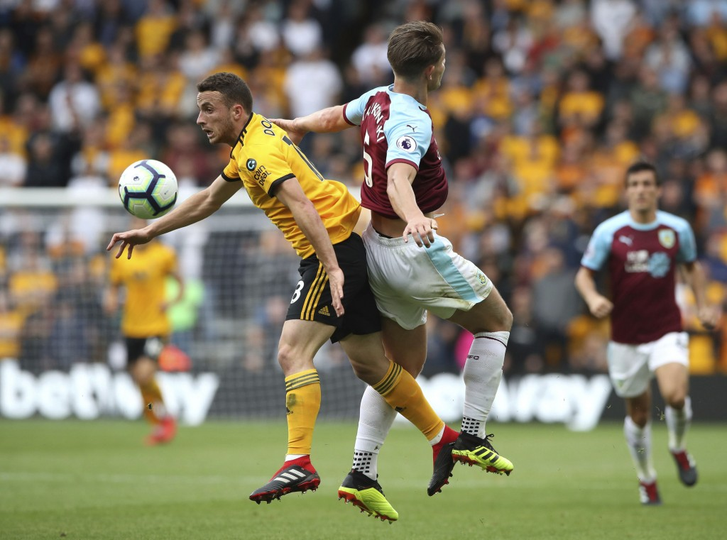 Wolverhampton Wanderers' Diogo Jota, left, and Burnley's James Tarkowski during their English Premier League soccer match at Molineux stadium in Wolve