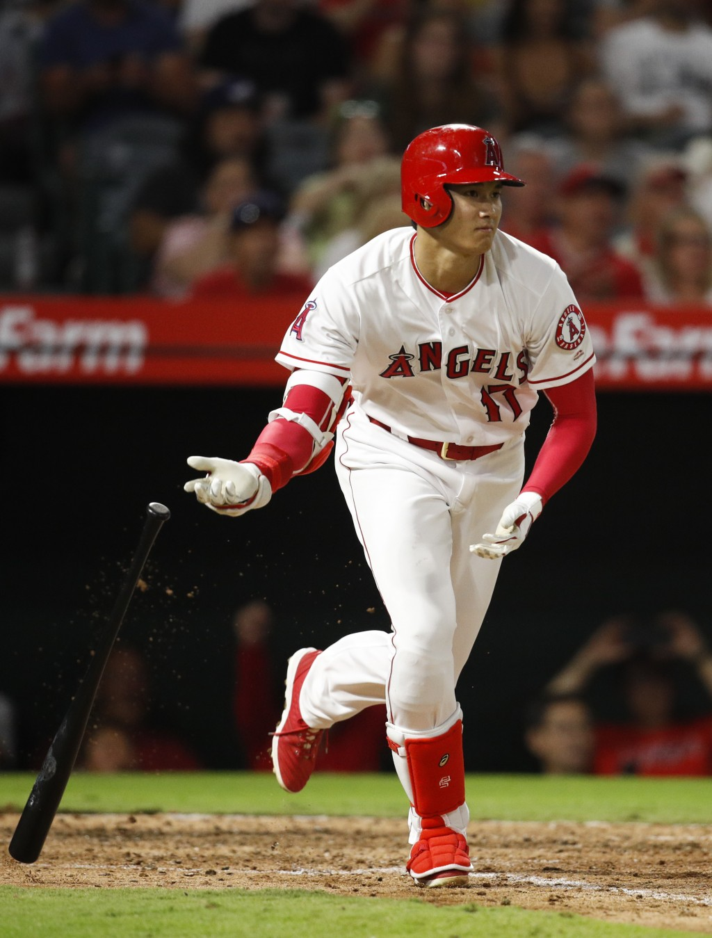 Los Angeles Angels' Shohei Ohtani, of Japan, tosses his bat after hitting a single during the sixth inning of a baseball game against the Seattle Mari