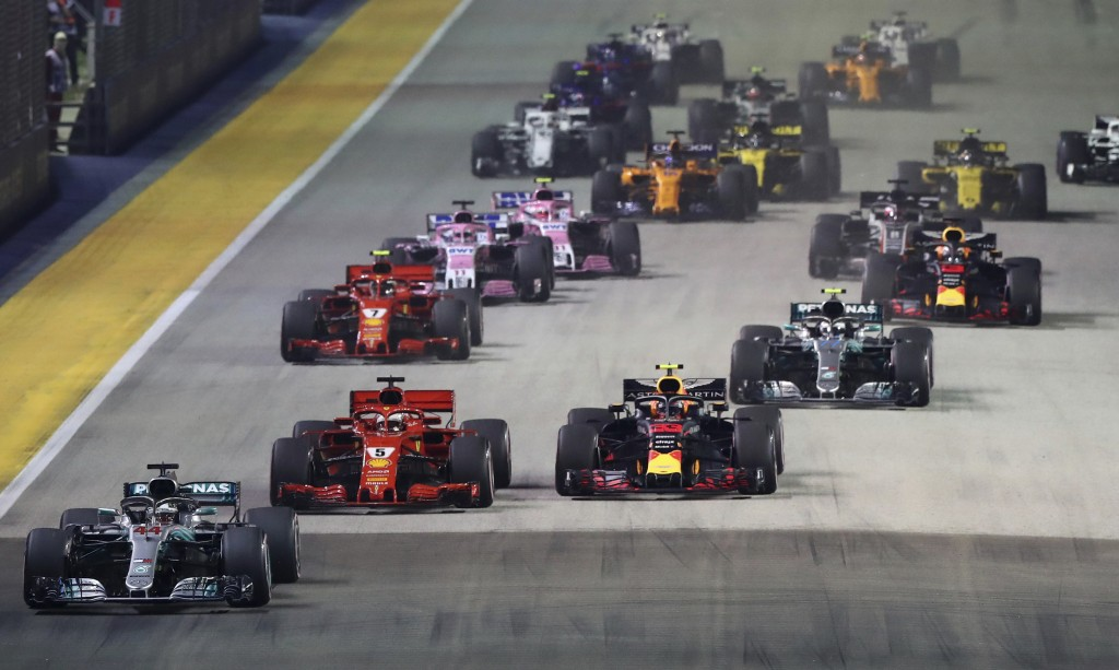 Mercedes driver Lewis Hamilton of Britain leads the field into turn one at the start of the Formula One Grand Prix of Singapore at Marina Bay Street C