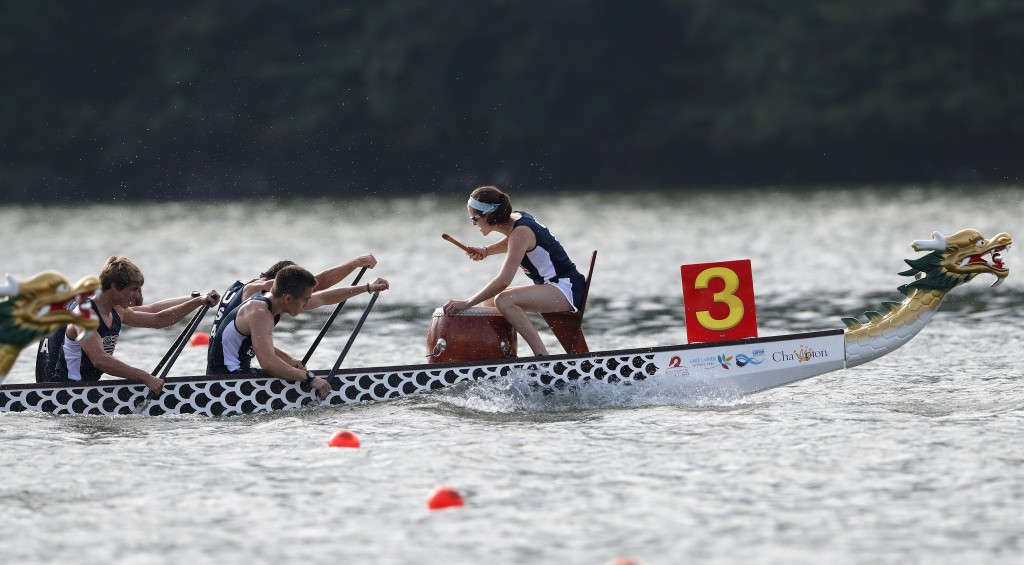 In this Thursday, Sept. 13, 2018 photo, a drummer sets the paces as a dragon boat crew from the USA paddles for the finish line during a 500-meter hea