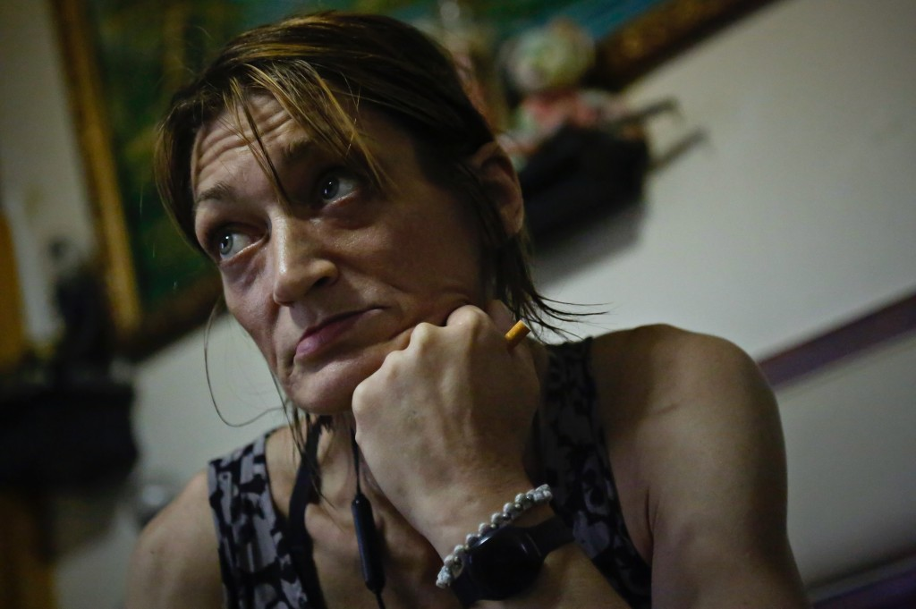 Jessie Kruger, a former heroin user who quit more than a year ago after a scary episode, listens during a conversation about using fentanyl strips, We