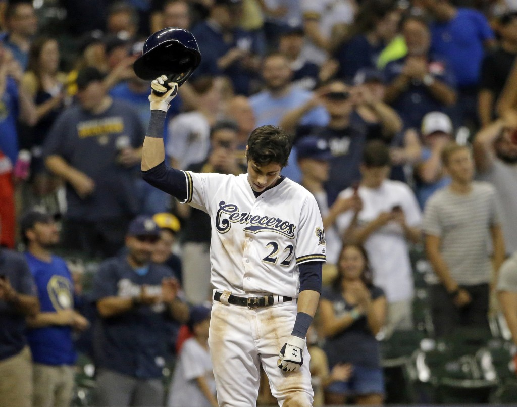 FILE - In this Monday, Sept. 17, 2018, file photo, Milwaukee Brewers' Christian Yelich reacts after receiving a standing ovation from the crowd after