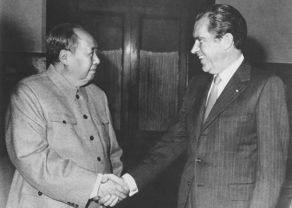 FILE - In this Feb. 21, 1972, file photo, Chinese communist party leader Mao Zedong, left, and U.S. President Richard Nixon shake hands as they meet i...