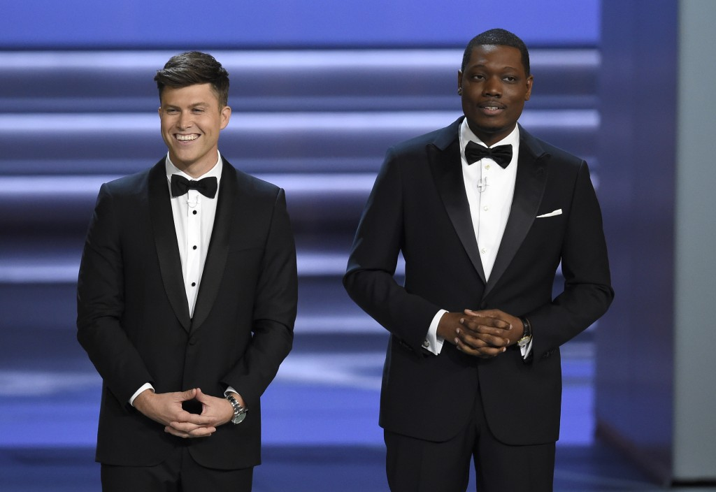 Hosts Colin Jost, left, and Michael Che speak at the 70th Primetime Emmy Awards on Monday, Sept. 17, 2018, at the Microsoft Theater in Los Angeles. (P...