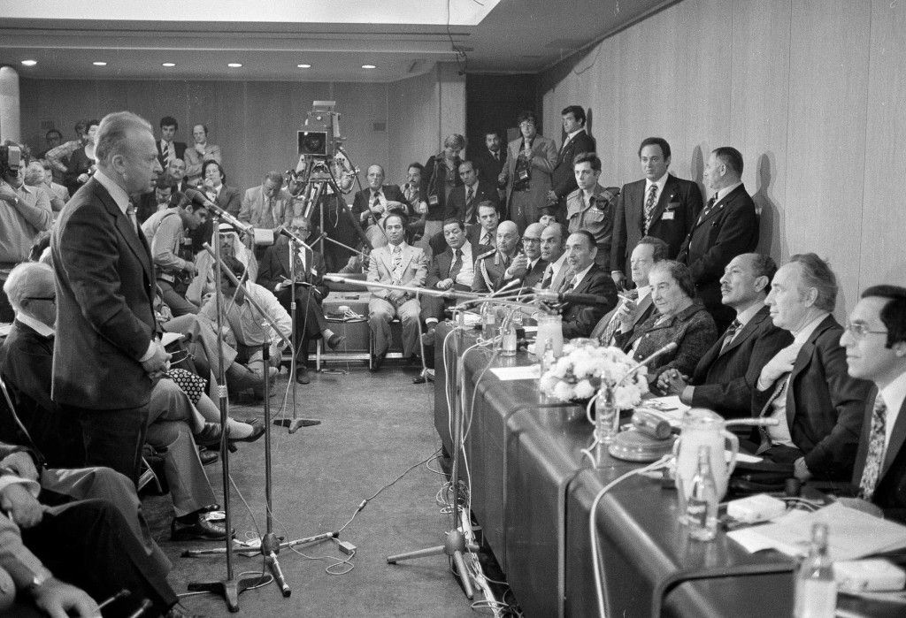 FILE - In this Nov. 21, 1977, file photo, Egyptian President Anwar Sadat is flanked by Israeli Labor Party leader Shimon Peres, right, and former Isra...