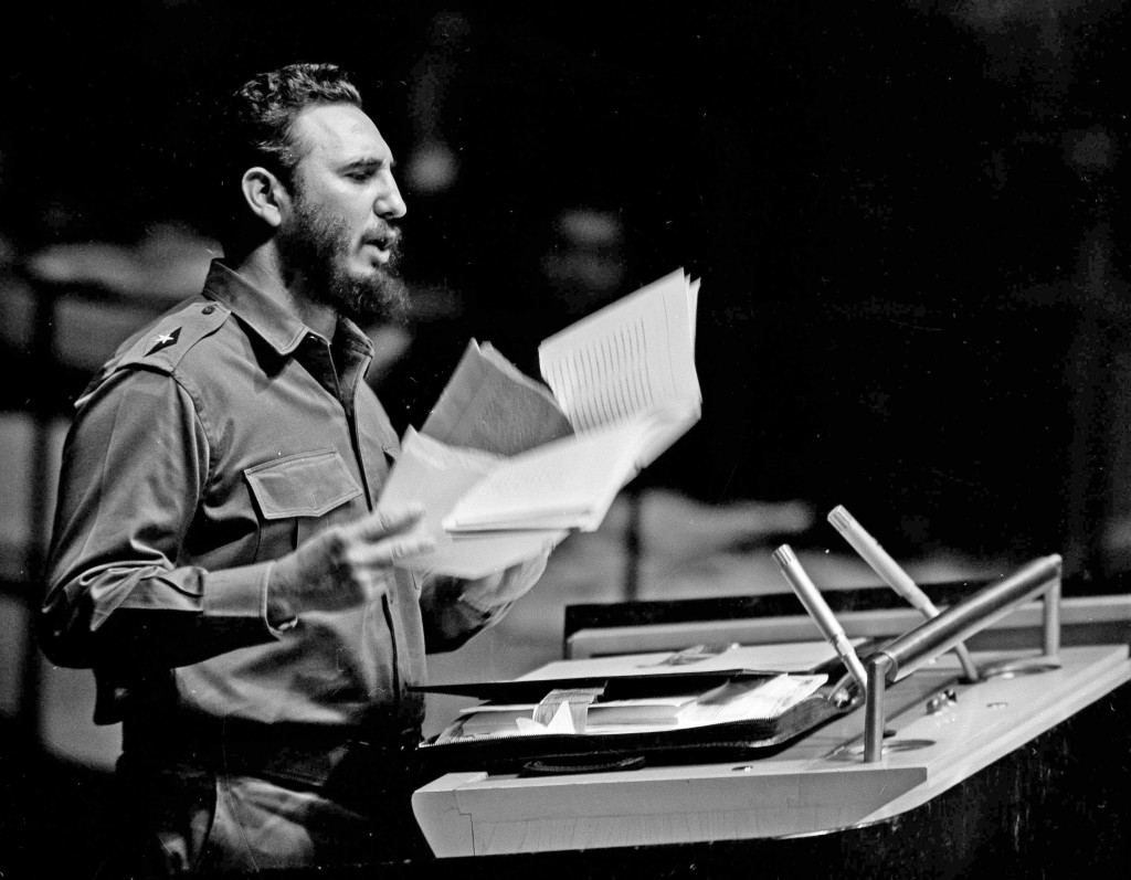 FILE - In this Sept. 26, 1960, file photo, Cuban Premier Fidel Castro waves a document during his talk to the United Nations General Assembly. The she