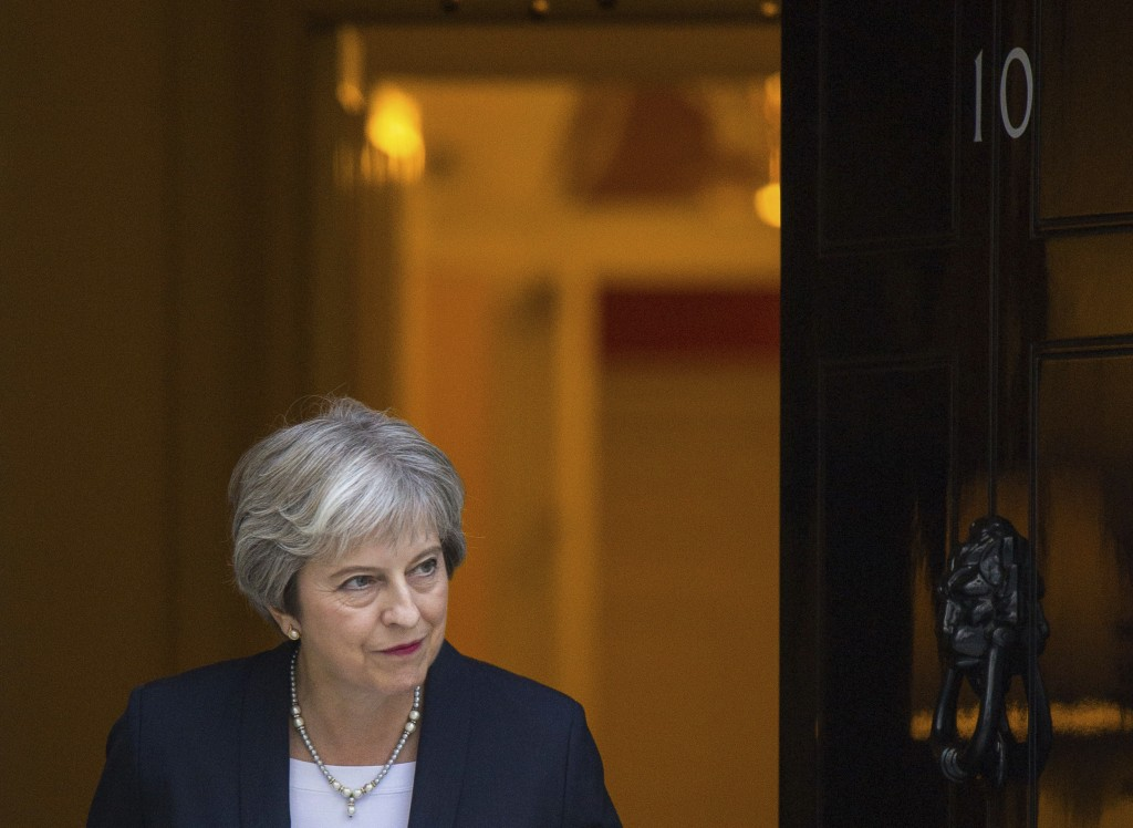 Britain's Prime Minister Theresa May waits to greet her Maltese counterpart Joseph Muscat to 10 Downing Street in London ahead of talks Monday Sept