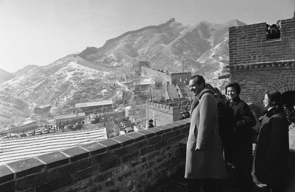 FILE - In this Feb. 24, 1972, file photo, President Richard Nixon, with Chinese guides and interpreters, stands on the Great Wall of China outside Pek
