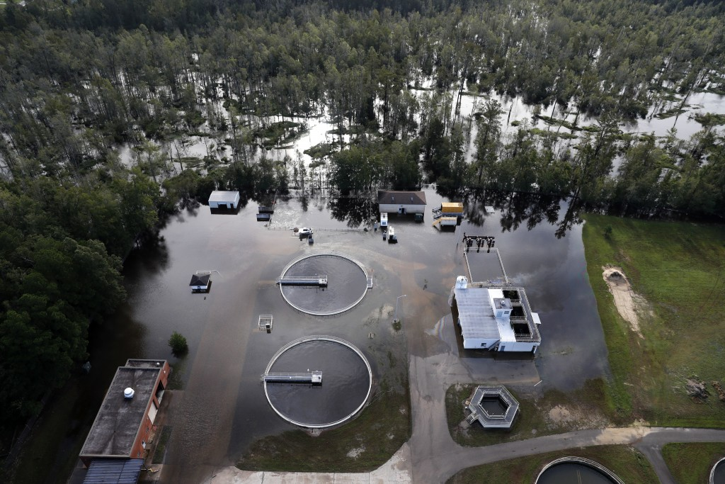 A wastewater treatment plant is inundated from floodwaters in the aftermath of Hurricane Florence in Marion, S.C., Monday, Sept. 17, 2018. (AP Photo/G...