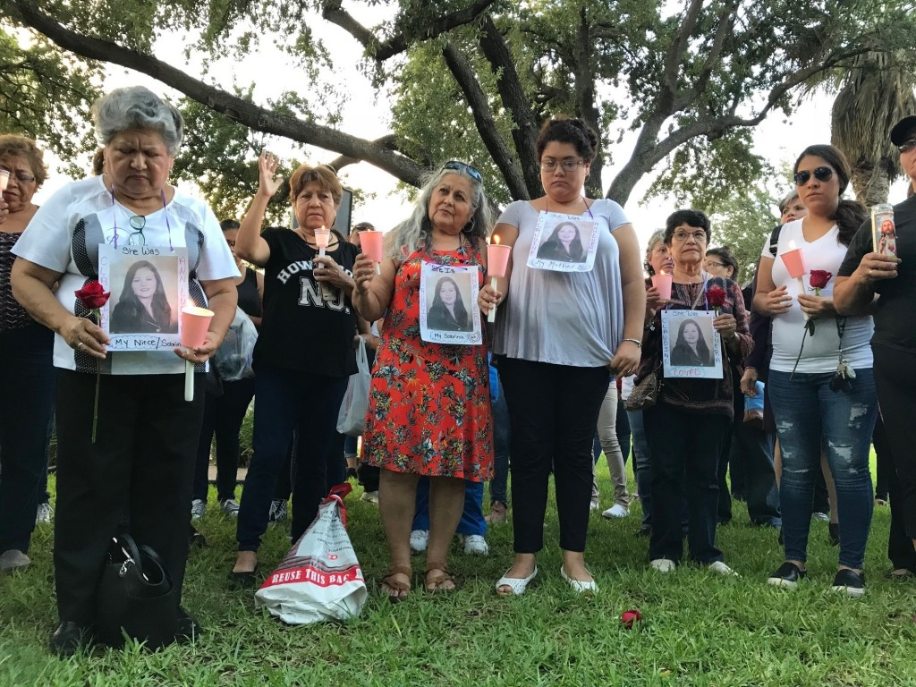 Dozens of family members and friends of four women who authorities say were killed by a U.S. Border Patrol agent gather for a candlelight vigil at a p