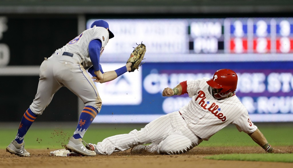 Philadelphia Phillies' Jorge Alfaro, right, steals second base past the tag from New York Mets second baseman Jeff McNeil during the second inning of ...