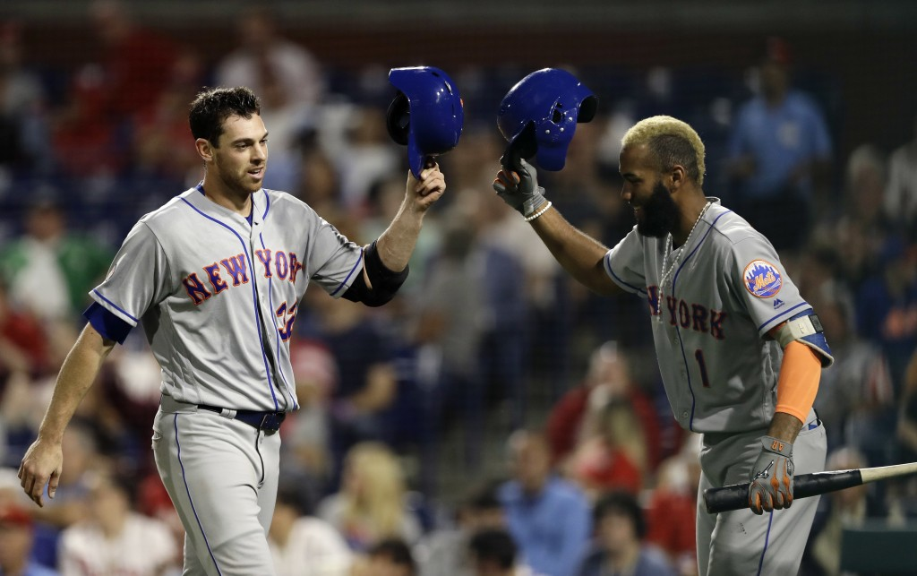 New York Mets' Steven Matz, left, and Amed Rosario celebrate after Matz's home run during the third inning of the team's baseball game against the Phi...