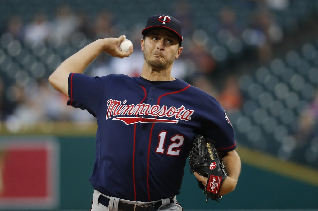 Minnesota Twins pitcher Jake Odorizzi throws to a Detroit Tigers batter during the first inning of a baseball game in Detroit, Tuesday, Sept. 18, 2018
