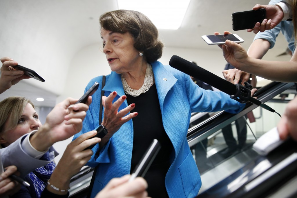 Sen. Dianne Feinstein D-Calif. is surrounded by reporters as she arrives for a vote Tuesday Sept. 18 2018 on Capitol Hill in Washington. (AP Pho