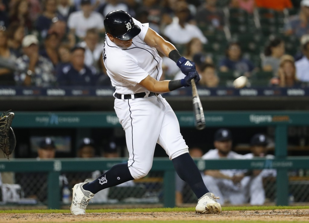 Detroit Tigers' Mikie Mahtook hits a two-run triple during the seventh inning against the Minnesota Twins in a baseball game in Detroit, Tuesday, Sept
