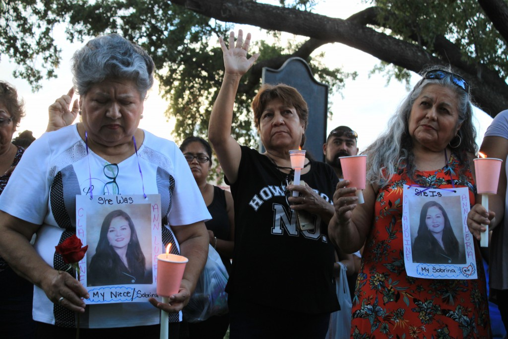 Dozens of family members and friends of four women who authorities say were killed by a U.S. Border Patrol agent gather for a candlelight vigil at a p...