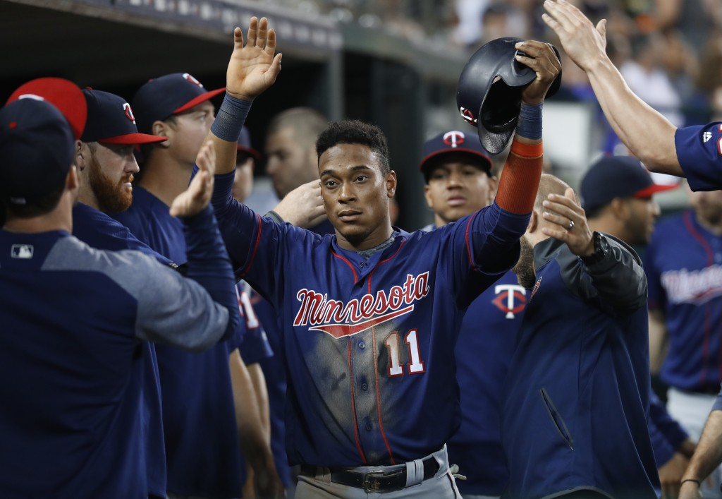 Minnesota Twins' Jorge Polanco (11) is congratulated after scoring during the sixth inning of the team's baseball game against the Detroit Tigers in D