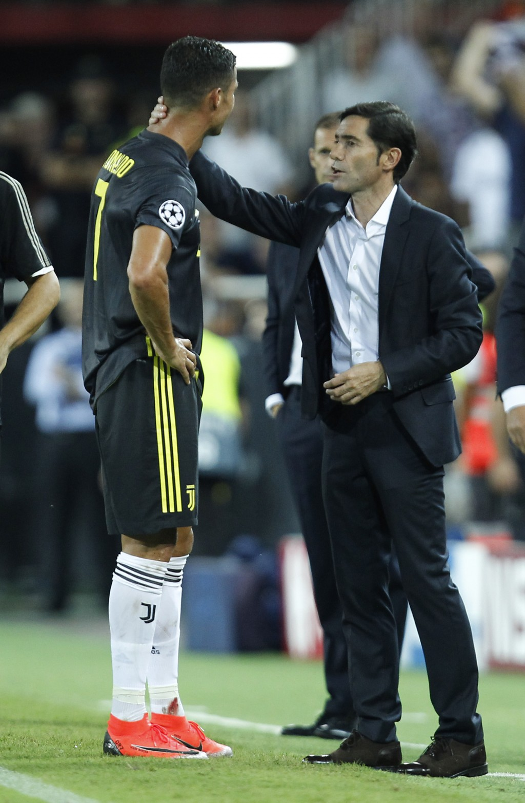 Juventus' Cristiano Ronaldo is consoled by Valencia coach Marcelino Garcia as he walks off the pitch after getting a red card during the Champions Lea