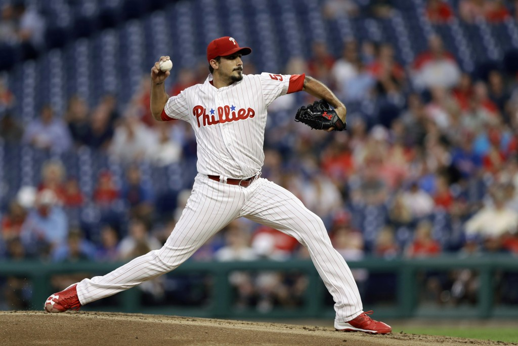 Philadelphia Phillies' Zach Eflin pitches during the third inning of a baseball game against the New York Mets, Wednesday, Sept. 19, 2018, in Philadel...