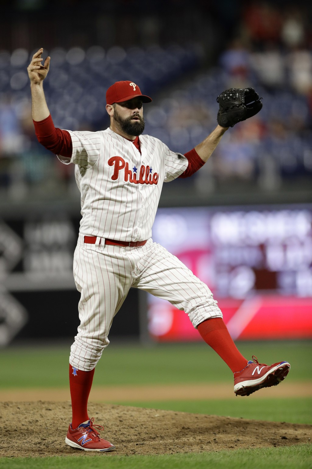 Philadelphia Phillies relief pitcher Pat Neshek reacts to a call while pitching against New York Mets' Kevin Plawecki during the ninth inning of a bas...