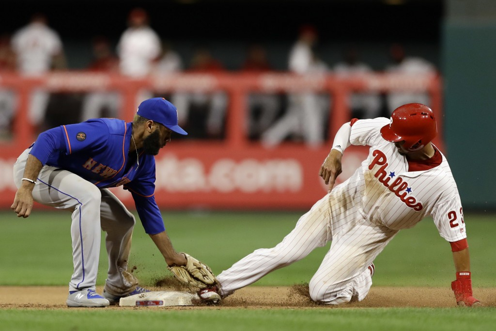Philadelphia Phillies' Aaron Altherr, right, steals second base past New York Mets shortstop Amed Rosario during the eighth inning of a baseball game,...