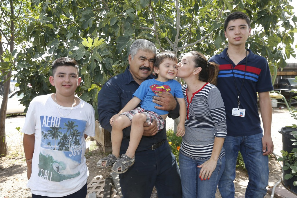 From left, Roman, Ruben, Rafael, Katy, and Ruben, pose for an photo in front of their house in Tucson, Ariz., on Tuesday, Sept. 4, 2018. Moroyoqui, 45...