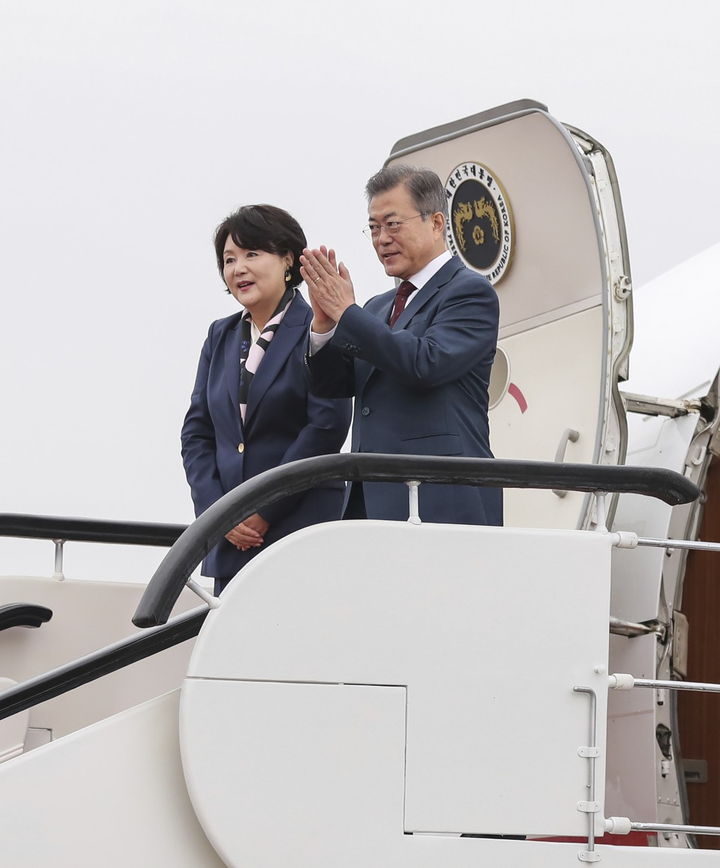South Korean president Moon Jae-in right and first lady Kim Jung-sook leave for Seoul at Samjiyon airport in North Korea Thursday Sept. 20 2018
