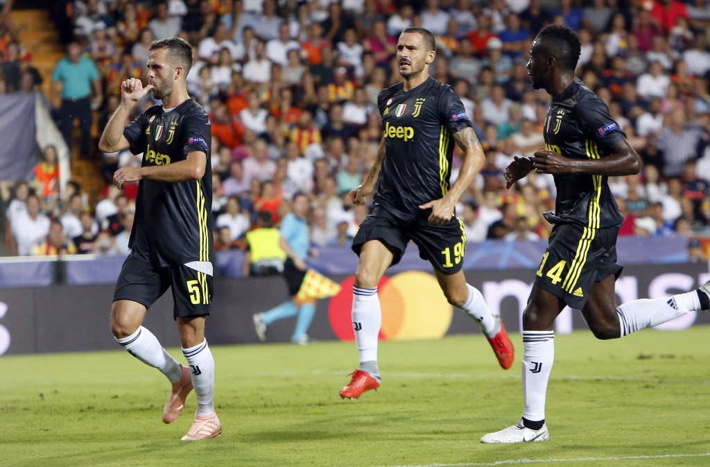 Juventus midfielder Miralem Pjanic, left, celebrates with teammates Leonardo Bonucci and Blaise Matuidi, right, after scoring on a penalty during the