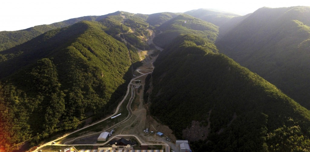 In this Sept. 9, 2018 photo, a general view of the downhill slope of the 2018 Pyeongchang Winter Olympics is seen at the Jeongseon Alpine Center in Je...