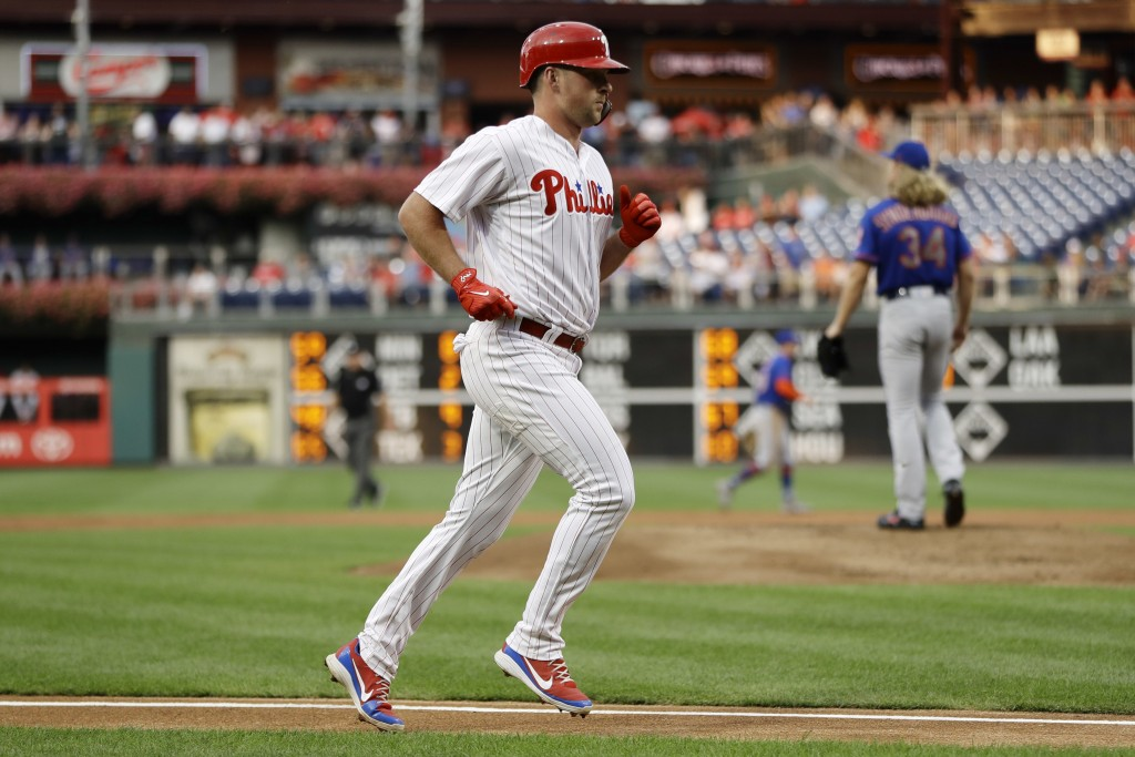 Philadelphia Phillies' Rhys Hoskins, left, rounds the bases after hitting a home run off New York Mets starting pitcher Noah Syndergaard, left, during...