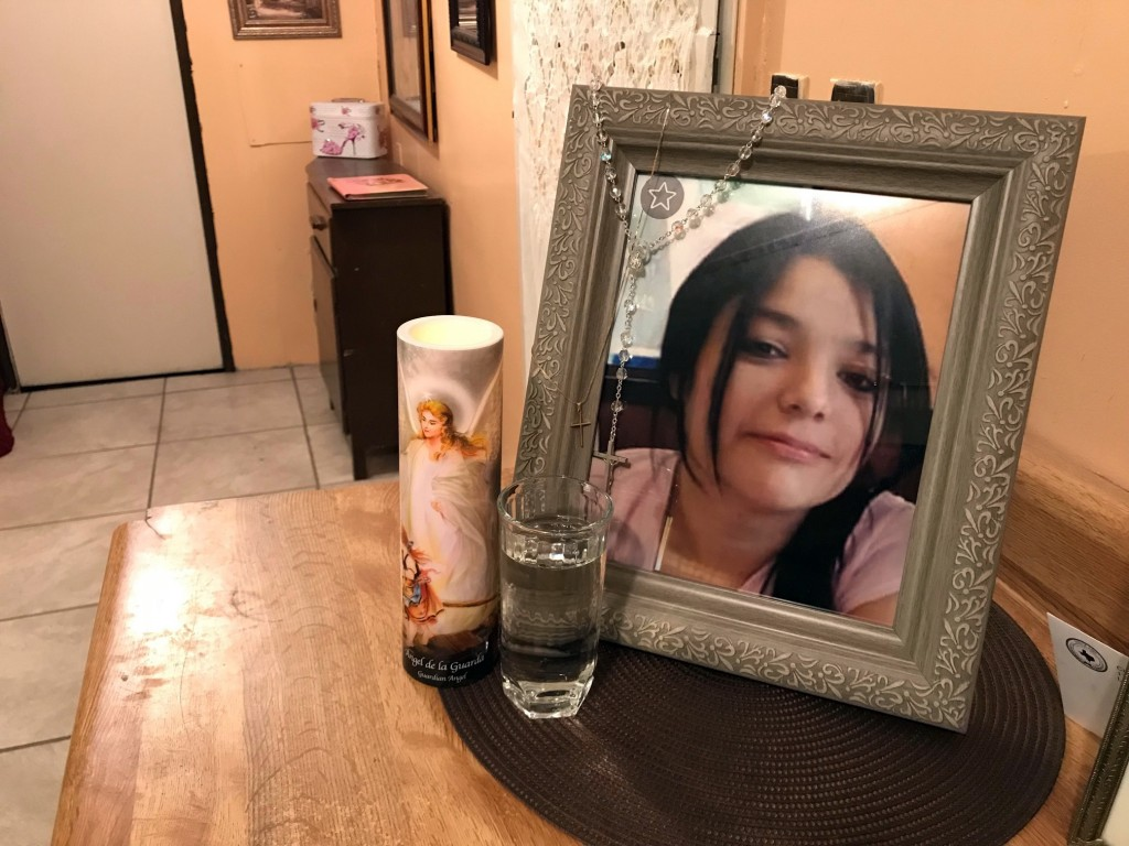 A framed photo of Melissa Ramirez sits at the end of a makeshift altar in her mother's home in Rio Bravo, Texas, on Tuesday, Sept. 18, 2018. (AP Photo