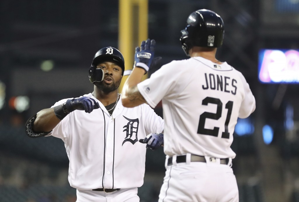 Detroit Tigers' Christin Stewart, left, is greeted by JaCoby Jones at home plate after both scored on Stewart's two-run home run during the first inni