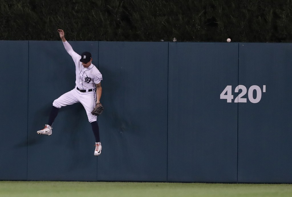 Detroit Tigers center fielder JaCoby Jones jumps but is unable to catch the two-run home run by Kansas City Royals' Hunter Dozier during the fourth in