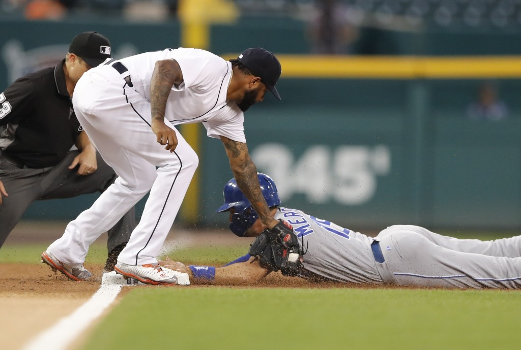 Kansas City Royals' Whit Merrifield beats the tag of Detroit Tigers third baseman Ronny Rodriguez and steals third during the first inning of a baseba