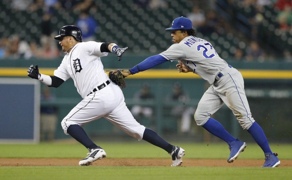 Detroit Tigers' Victor Martinez, left, is caught in a rundown by Kansas City Royals second baseman Adalberto Mondesi during the first inning of a base