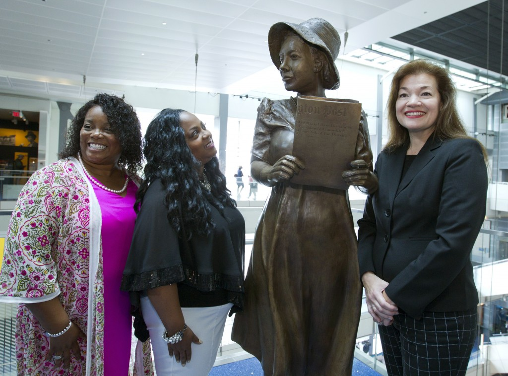 From left, Penny Allison Lockhart and Angela Alice Stephens, great nieces of Alice Allison Dunnigan, stand with sculpture artist Amanda Matthews durin...