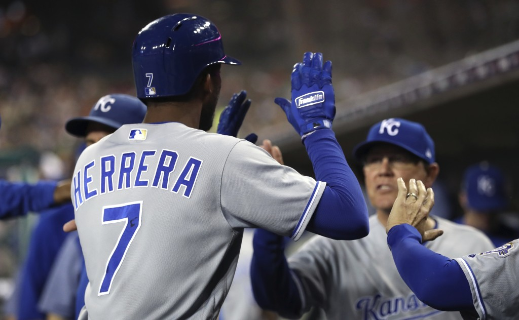 Kansas City Royals' Rosell Herrera (7) is greeted in the dugout after scoring during the fourth inning of a baseball game against the Detroit Tigers,