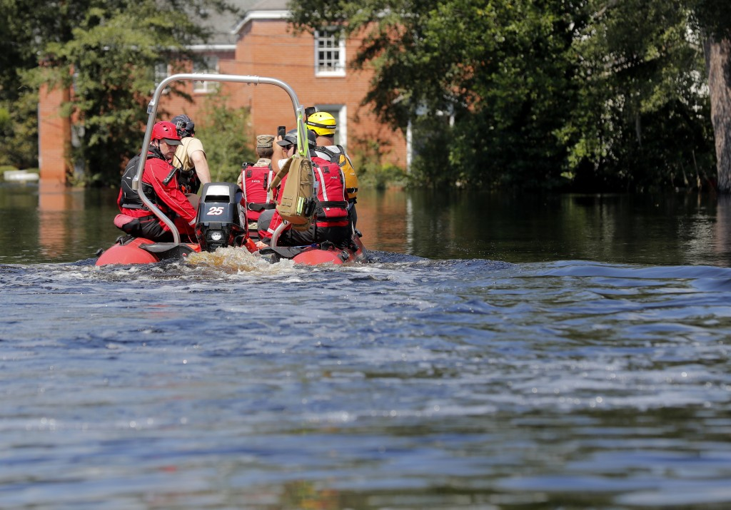 A swift recuse boat motors through floodwaters in the aftermath of Hurricane Florence in Nichols, S.C., Friday, Sept. 21, 2018. Virtually the entire t