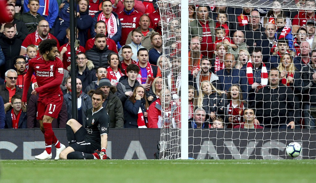 Liverpool's Mohamed Salah attempts a back heel near the Southampton goal, during the English Premier League soccer match between Liverpool and Southam...