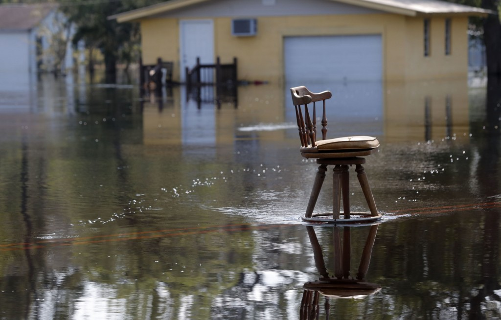 A stool sits in the middle of a roadway in floodwaters in the aftermath of Hurricane Florence in Nichols, S.C., Friday, Sept. 21, 2018. Virtually the