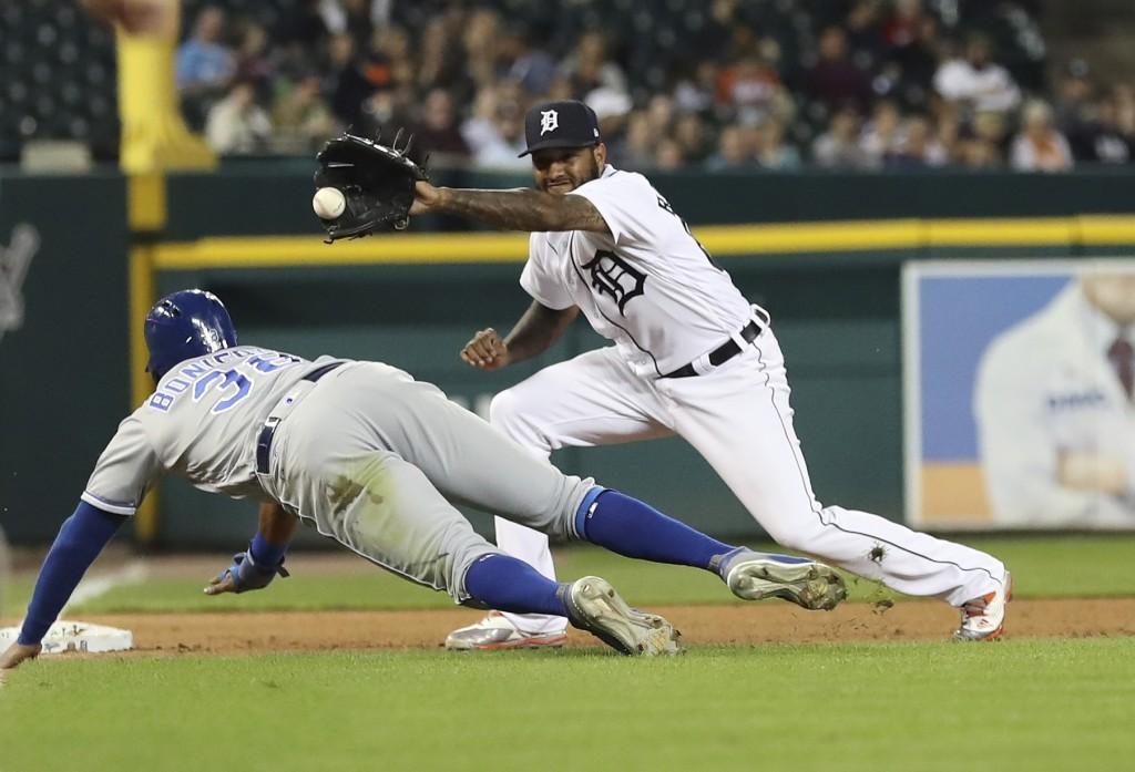 Detroit Tigers third baseman Ronny Rodriguez, right, waits on the throw from catcher James McCann to tag out Kansas City Royals' Jorge Bonifacio, left