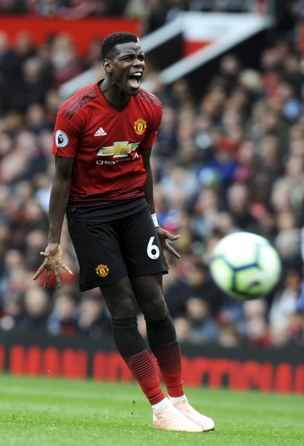 Manchester United's Paul Pogba reacts during the English Premier League soccer match between Manchester United and Wolverhampton Wanderers at Old Traf...