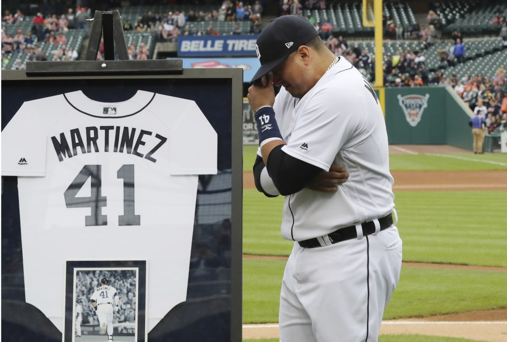 Detroit Tigers designated hitter Victor Martinez holds back tears during an on-field ceremony before the team's baseball game against the Kansas City