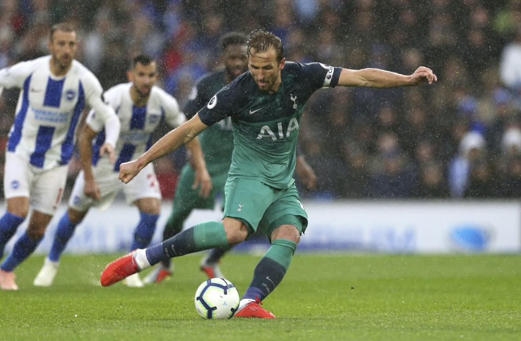 Tottenham Hotspur's Harry Kane scores his side's first goal of the game from the penalty spot against Brighton & Hove Albion during the English Premie...