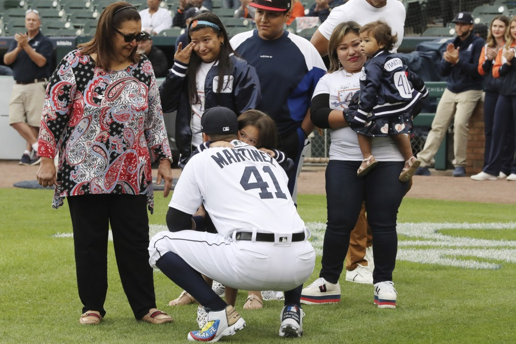 Detroit Tigers designated hitter Victor Martinez hugs a family member before a baseball game Saturday, Sept. 22, 2018, in Detroit. Martinez is playing