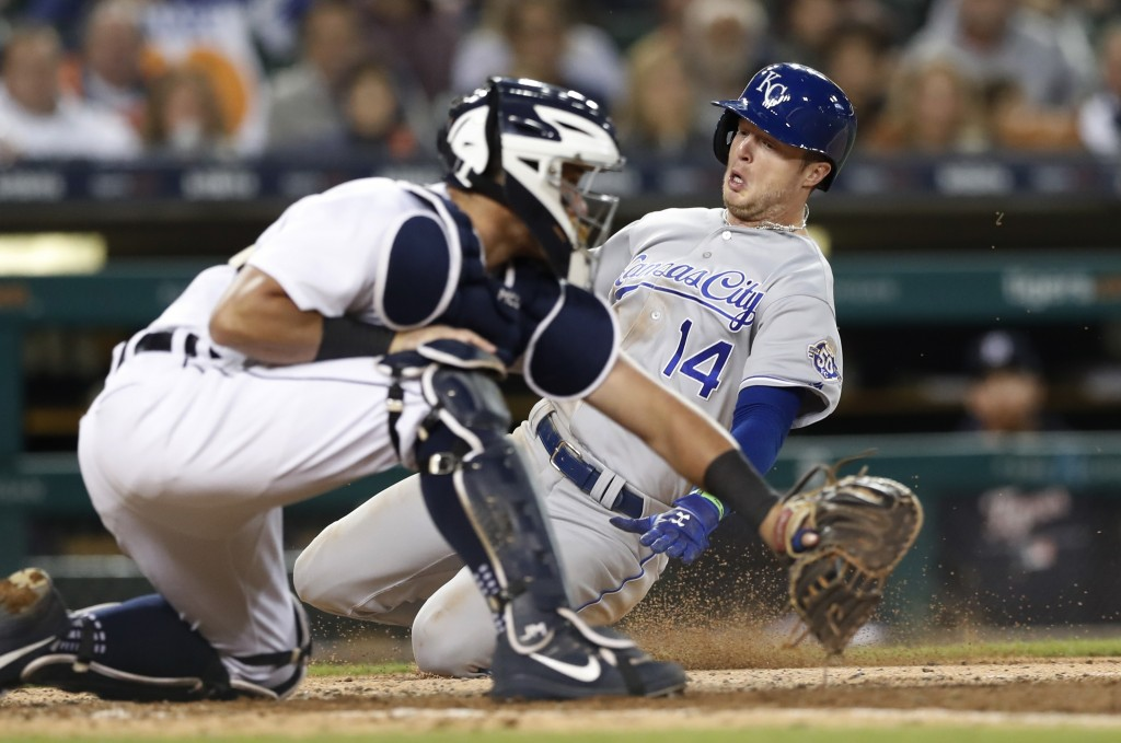 Kansas City Royals' Brett Phillips beats the throw to Detroit Tigers catcher James McCann to score during the eighth inning of a baseball game Saturda