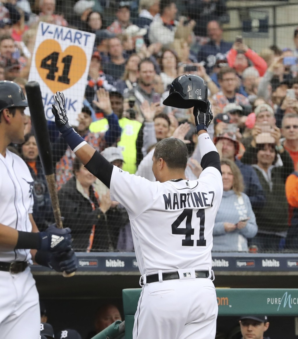 Detroit Tigers designated hitter Victor Martinez acknowledges the fans after his single against the Kansas City Royals during the first inning of a ba