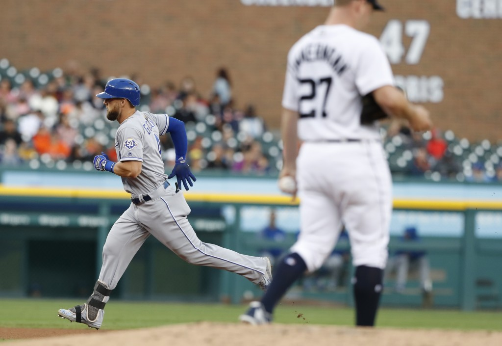 Kansas City Royals' Alex Gordon rounds the bases after his solo home run as Detroit Tigers starting pitcher Jordan Zimmermann (27) walks on the mound