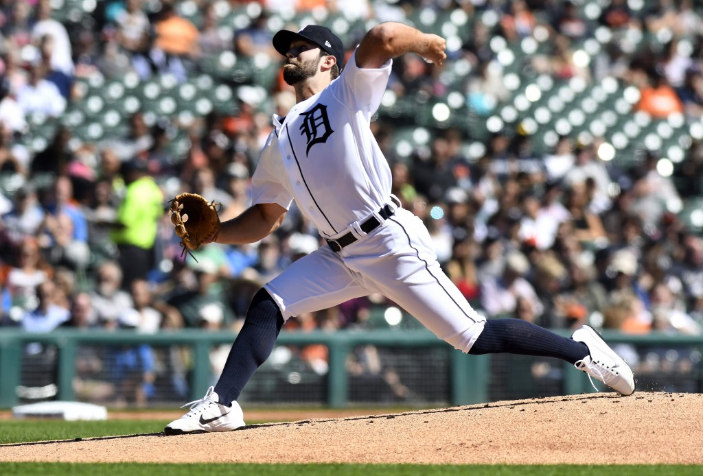 Detroit Tigers starting pitcher Daniel Norris throws against the Kansas City Royals during the first inning of a baseball game in Detroit, Sunday, Sep