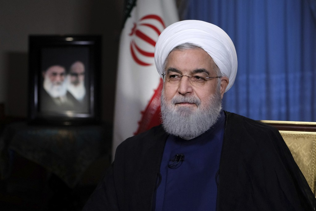 FILE - In this Monday, Aug. 6, 2018 file photo released by official website of the office of the Iranian Presidency, President Hassan Rouhani addresse...